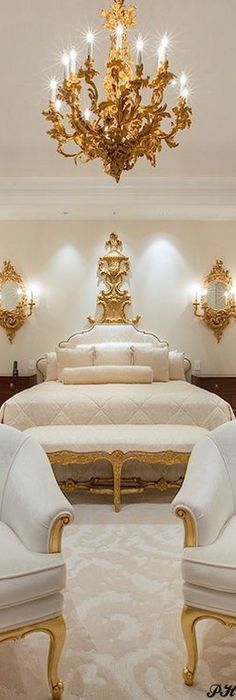The gilded chandelier & all the antiques w/ gilt wood create such luxury in this Master Bedroom Suite.