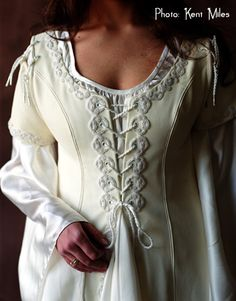 Long-sleeved medieval-style gowns are perfect for the winter Celtic wedding!