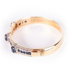 Renee Lewis Jewelry Renee Lewis Diamond and Sapphire Hinged Bangle Bracelet ($13,000) found on Polyvore