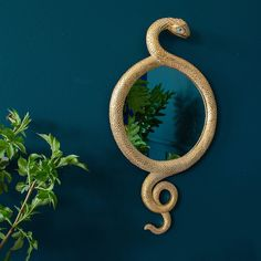 A slinky gold snake mirror to spice up your walls. Enliven a gallery wall with the gold snake mirror's seductive curves that contrast well with geometric pictures. Unique Mirrors, Cool Mirrors, Beautiful Mirrors, Goth Home Decor, Quirky Home Decor, Home Decor Accessories, Decorative Accessories, Accessories Online, Bathroom Accessories