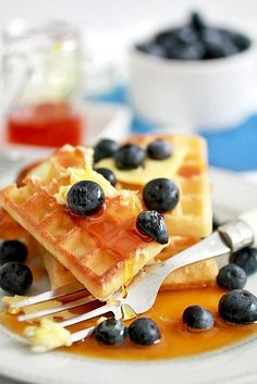 One of the best breakfast classics ever! Waffles swimming in syrup and fresh blueberries. #waffles #blueberries #fruit #brunch #food #breakfast #maple #syrup