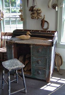 (This actually an old cobbler's work table. My mother has one that she bought with alot of the old tools still in the drawers and with a cobbler's bench. Beautiful) primitive desk