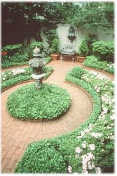 Design idea: black tiered fountain in center, boxwood hedges filled with roses, black metal furniture. (Savannah, GA garden)