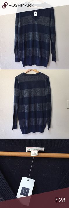"""NWT Gap blue v-neck sweater NWT Gap blue v-neck sweater. The stripes are made from silver and blue metallic thread. Size large. Fabric consists of 70% cotton, 21% polyester, and 9% metallic. Approximate length is 31"""" and approximate chest measurement is 22"""". GAP Sweaters V-Necks"""