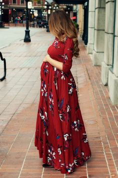I like the 3/4 sleeves on this long floral dress. The color is nice too!