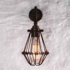 Cage Single Arm Wall Light in Antique Brass