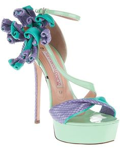 Green and blue leather platform sandal from Gianmarco Lorenzi featuring a python print twisted strap across the foot, a buckled strap around the ankle and a bouquet of twisted python print strips.