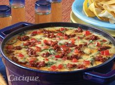 Recipe for Queso Fundido (featured on The Today Show). Save on this recipe! Take the Queso IQ Challenge and claim your coupon for new Cacique Shredded Cheese.
