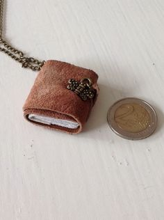 Minibook real leather, handbinding, writing and torn pages = pendant for my daughter. In it her family tree.