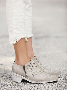 dove grey American made booties with leather stitch detailing on the front.