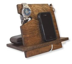 This cell phone docking station also holds your wallet, watch, and keys! Great for keeping all of your essential, everyday items organized and