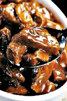 SIRLOIN BEEF TIPS Serves 1 salt and pepper garlic powder 2 tablespoons all purpose flour 1 tablespoon olive oil 4 to 6 ounces sirloin steak, cut into large dice 1 small onion, diced 2 tablespoons butter 4 large mushrooms, sliced cup white wine cup Beef Tip Recipes, Crockpot Recipes, Cooking Recipes, Sirloin Steak Recipes, Steak Tips, Beef Sirloin, Kabob Recipes, Fondue Recipes, Recipies