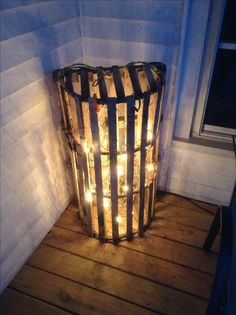 Lobster trap with Christmas lights.