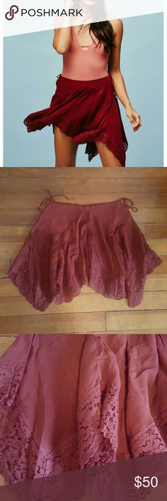 Free People Half-Slip Brand new, no tags.  Flowy half-slip with an uneven lace adorned hem. Wide waistband with adjustable ties on the side to create an effortless fit. Wine colored.  100% rayon Free People Skirts Asymmetrical