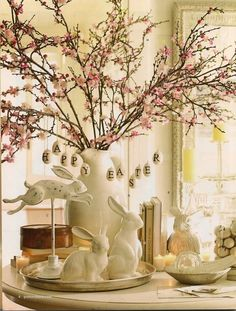 Easter inspiration - white bunnies, spring branches in vase