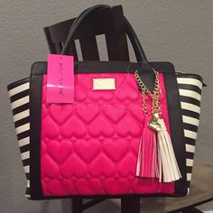 Betsey Johnson bag Beautiful new Betsey Johnson satchel!  The tassel wing fushia bag with black & white striped sides.  Zip picket & two open pockets inside.  Gold hardware.  Beautiful!!!  New with tag attached. Betsey Johnson Bags Satchels