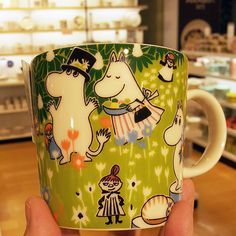 Who wouldn't love friendly Moomins? Tove 100 anniversary mug has a sketch from Moomins garden party.
