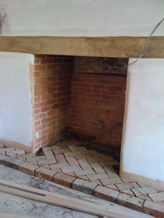 Fireplace with herringbone brick hearth