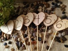Set of 6 Table Number Wood Hearts for your Rustic Wedding Bridal Shower Baby Shower Engagement Party So Woodland Chic Decorations. $38.99, via Etsy.