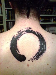 It's an incomplete circle, inked in a brush drawing style. Originating from Japan, Enso circle is strongly associated with Zen, school of Mahayana Buddhism.