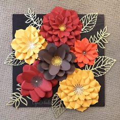 Paper Flower Wall decor in Fall Colors by CynDetails (IG @cyndetails) . Wooden backboard measures at 24 inches all around.