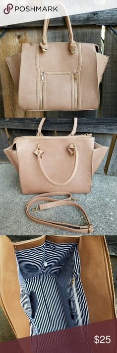 """NWOT Large Beige Purse with Gold Accents Stash everything you can think of in this large chic handbag. Made of pebbled faux leather with gold accents. Has two pockets on the front, and three pockets on the inside. Zippered top. Comes with long removable strap. Wing style bag, so sides flare out.   Measures 13'' wide and 5.5'' deep at the base, and 11.5'' tall.   Actual color is slightly darker than in my photos.  Ideal for a student or a busy working lady :)  """"Wing Woman"""" handbag from Lulus…"""