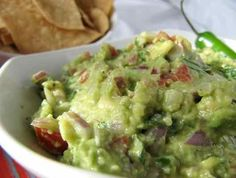 Spicy Seasoned Loaded Guacamole | Ingredients 2 avocados, fairly soft, peeled and pit removed 1 tablespoon lime juice ¼ teaspoon white wine vinegar ½ red onion, minced 1 Serrano pepper, minced 2 tablespoons chopped cilantro 1 roma tomato, pulp removed, then diced ½ teaspoon salt ¼ teaspoon freshly ground black pepper 1/8 teaspoon cumin 1/8 teaspoon garlic powder Preparation 1In []