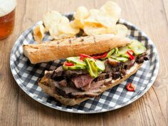 For a great summer grill-out sandwich, Guy starts with marinated lamb meat and layers on flavorful toppings for his Grilled Lamb Sandwiches.