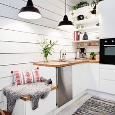 Scandinavian Style Kitchen With Double Black Pendant Lighting And White Cabinets With Butcher Block Countertop And And Open Shelving And Pot Plants And Small Bench , Bright Scandinavian Style Kitchen In Kitchen Category