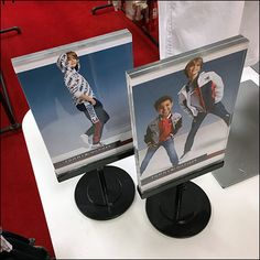 While the striking Tommy Hilfiger Twin-Table-Top-Signs are perfect duplicates, different sign inserts perk up presentation. Price Signage, Back To School List, School Store, Store Fixtures, Pos, Retail Price, Visual Merchandising, Tommy Hilfiger, Twins