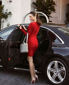 Miranda Kerr wearing a bombshell #red Herve Leger dress and #Louboutin shoes.