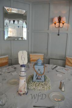 Gyp table centerpieces, Bickley Mill Inn wedding Devon.