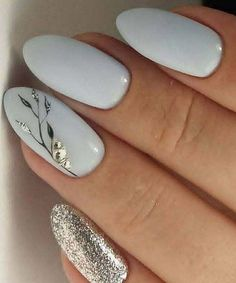 Nail art is a very popular trend these days and every woman you meet seems to have beautiful nails. It used to be that women would just go get a manicure or pedicure to get their nails trimmed and shaped with just a few coats of plain nail polish. White Nail Designs, Best Nail Art Designs, Gel Nail Designs, Nails Design, Flower Design Nails, Blue Nails With Design, Feather Nail Designs, Feather Nail Art, Pretty Nail Designs
