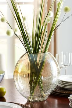 Bring your tabletop to life with a centerpiece featuring Pier 1's handblown Gold Luster Crackle Glass Vase and Faux Onion Grass Pom-Pom Sprays.
