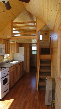 spacious tiny house on wheels by richs portable cabins 002 600x1067 Spacious Tiny House Living in Richs Portable Cabins. Like loft space. Feels private.