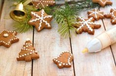 Gingerbread christmas cookies with decorating pen, green pine branch needles with bell and angel on wooden background,front horizontal view Gingerbread Cookies, Christmas Cookies, Pine Branch, Christmas Background, Wooden Background, Desserts, Recipes, Food, Angel