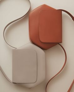 An elevated take on the off-duty shoulder bag, crafted from luxurious Italian smooth calf leather. Our Hexagon Crossbody features a statement-making, geometric shape with flap closure, spacious interior, and an adjustable strap. Fashion Handbags, Purses And Handbags, Fashion Bags, Leather Handbags, Luxury Handbags, Cheap Handbags, Leather Bags, Leather Totes, Luxury Purses