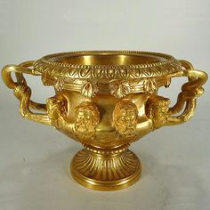 """Empire Style Ormolu 2-Handled Urn/Wine Cooler/Planter, 19th C., Mythological Heads in high relief, including: Bacchus, Nordsmen, Egyptian, etc and grape leaves and grape clusters, removable liner.  8""""H x 12""""w"""