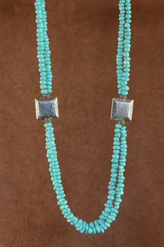 Featured in Cowboys & Indians April 2014 Spring Fashion issue.  Double strand of Campitos Turquoise and Sterling Silver.  $206.  By Laura Ingalls Designs.