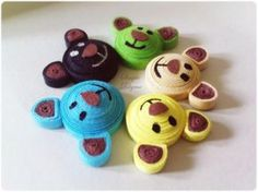Quilled teddy bear heads. Looks easy enough to add the bodies.