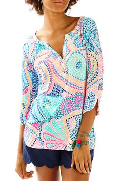 Printed tops are a staple in our wardrobe and we can never seem to get enough of them. The Egret Top is a printed knit henley that has a 3/4 sleeve and a button placket. Pair it with solid shorts and gold wedges for a chic warm weather look.  Egret Henley Top by Lilly Pulitzer. Clothing - Tops - Blouses & Shirts Sandestin Golf and Beach Resort Florida