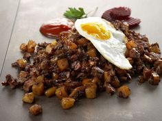 """Biksemad"", Danish hash made of yesterdays leftover meat from lamb, beef or venison, onions and potatoes, served with fried egg."