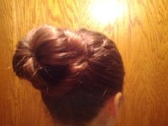 Sock bun with end hair twisted around base.