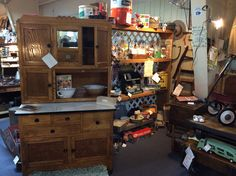 The latest edition H.J. Scheirich MFG. CO oak kitchen cabinet....at Antique Crossroads