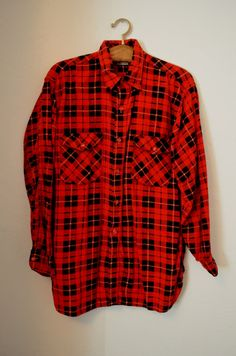 1960s red flannel.  Vintage button down.  Tartan red, and black plaid.  Done in a warm thick 100% cotton.  Warm and cozy for the winter!  Two