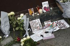 "<div class=""meta ""><span class=""caption-text "">Cards, candles and flowers are placed in front of the Carillon cafe in Paris Saturday Nov. 14, 2015. (AP Photo/ Jerome Delay)</span></div>"
