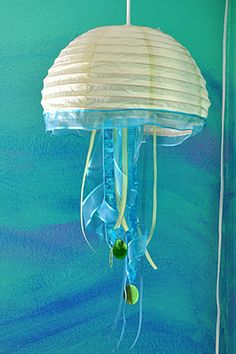 Jellyfish paper lantern night light. The economical version!  I am going to get the little ones at Michael's in their dollar bin and do this.