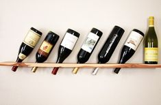 DIY Wood Plank Wine Rack by Camille Styles. cool :)