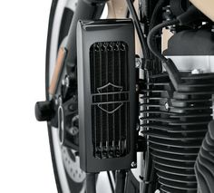"Premium Oil Cooler Kit-62700082 :: This oil cooler was designed specifically for Harley-Davidson® to out-perform all other coolers in the industry. The cooler features a unique ""Turbulator"" system that evenly distributes oil across the cooling chambers. The air fins are designed to efficiently dissipate heat. The oil cooler has been designed to simplify installation and enhance performance."