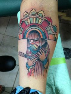http://tattoonewmexico.org - Colorful kachina forearm tattoo by Victor Vegas at Star Tattoo in Albuquerque, New Mexico